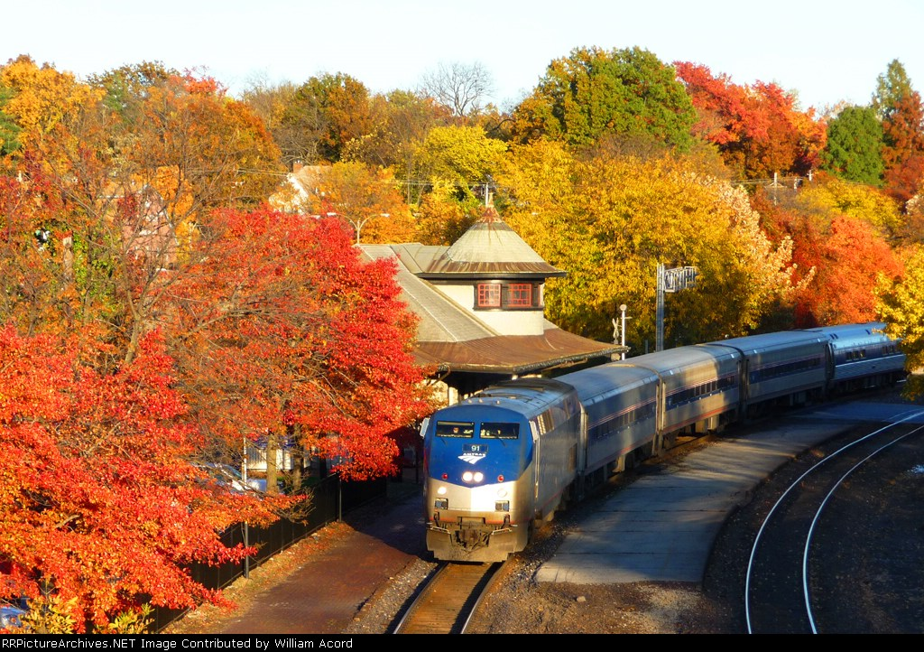 """Westbound Amtrak """"Missouri River Runner' amidst beautiful fall colors at their peak"""