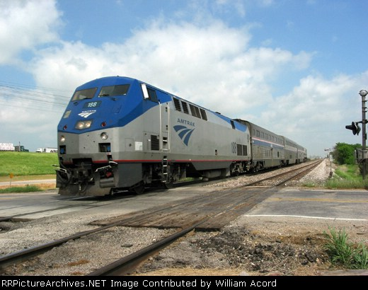 Southbound Heartland Flyer gliding toward Ft. Worth at track speed on a very warm Memorial Day weekend