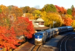 "Westbound Amtrak ""Missouri River Runner' amidst beautiful fall colors at their peak"