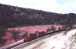 BNSF #2551 leading ballast train through Arbuckles