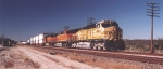 BNSF #4460 leading mixed stack train at track speed