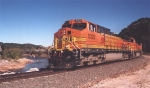 BNSF 5323 leading mixed freight along Washita River