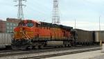 BNSF 5735 pusher providing extra power for westbound BNSF coal train as it passes downtown St. Louis Amtrak Station