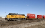Union Pacific #805 moving a cut of stack train cars southward