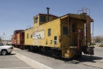 Retired Union Pacific and Santa Fe cabooses bake in the warm desert sun