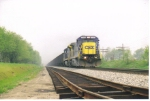 CSX 7585 takes hoppers east past the double track projest
