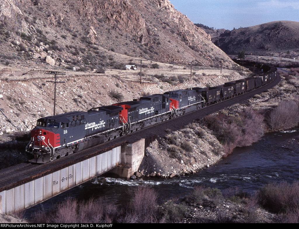 SP 114 144 349 is pulling an ore train on the ex- DRG&W's Tennessee Pass route,