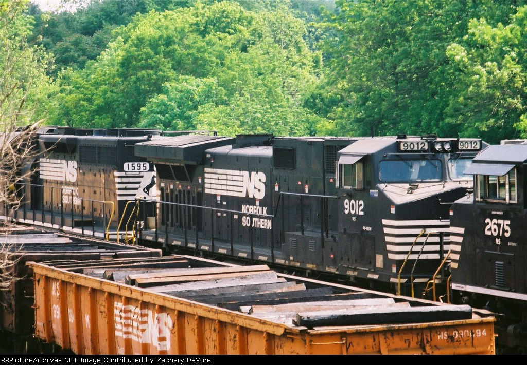 NS 9012 Appears over a load of Railroad Ties