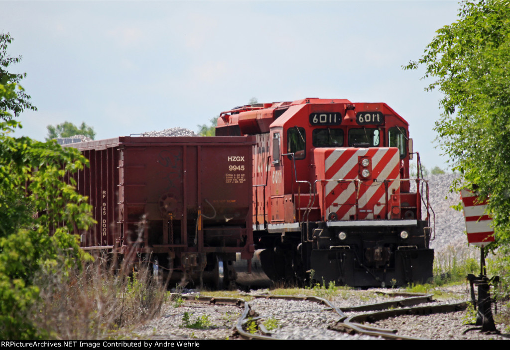 CP 6011 will be power for a Herzog rock train being loaded