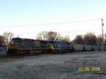 In early daylight, CSX train T113 passes Decatur depot