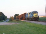 CSX 2713 and 6078 and a line of Woodchip Hoppers