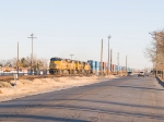 UP 5539 moves through the Pendale crossing heading WB into El Paso at 4:20 with his doublestack