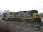 CSX 7495 & 9013 out in a quick rain shower