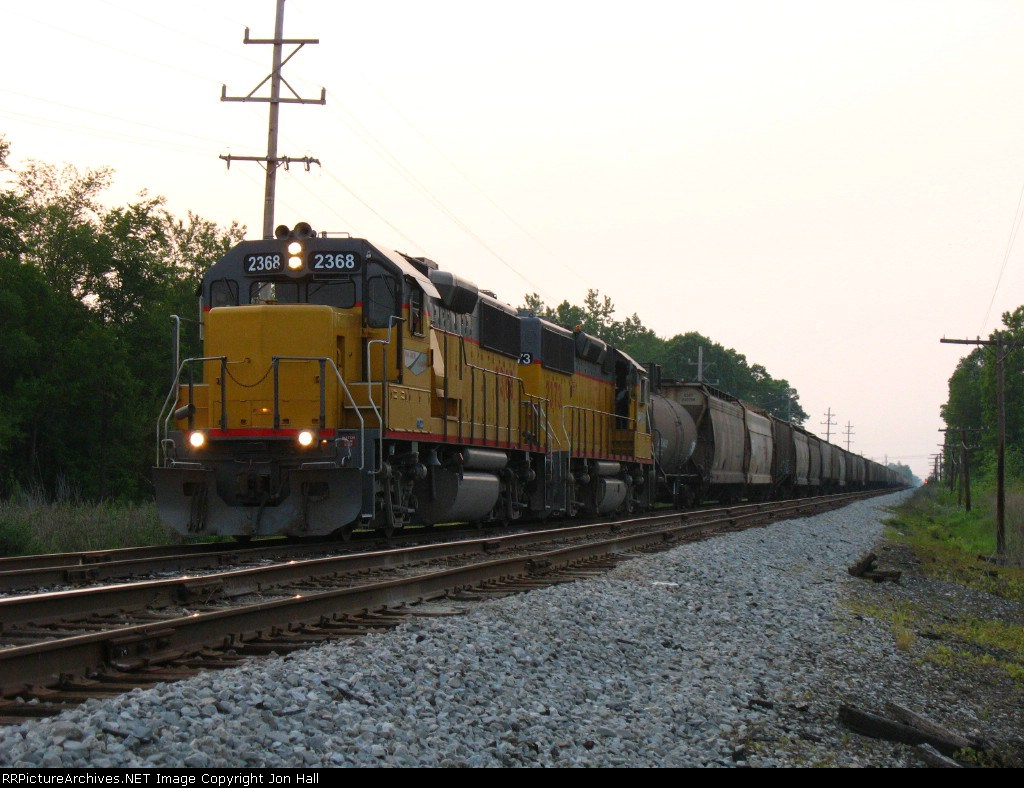AA 2368 & 2373 sitting in the siding with their train