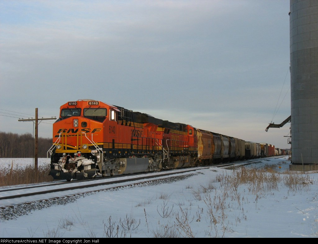 BNSF 6140 & 5602 with Q335 still waiting to continue their trip near sunset