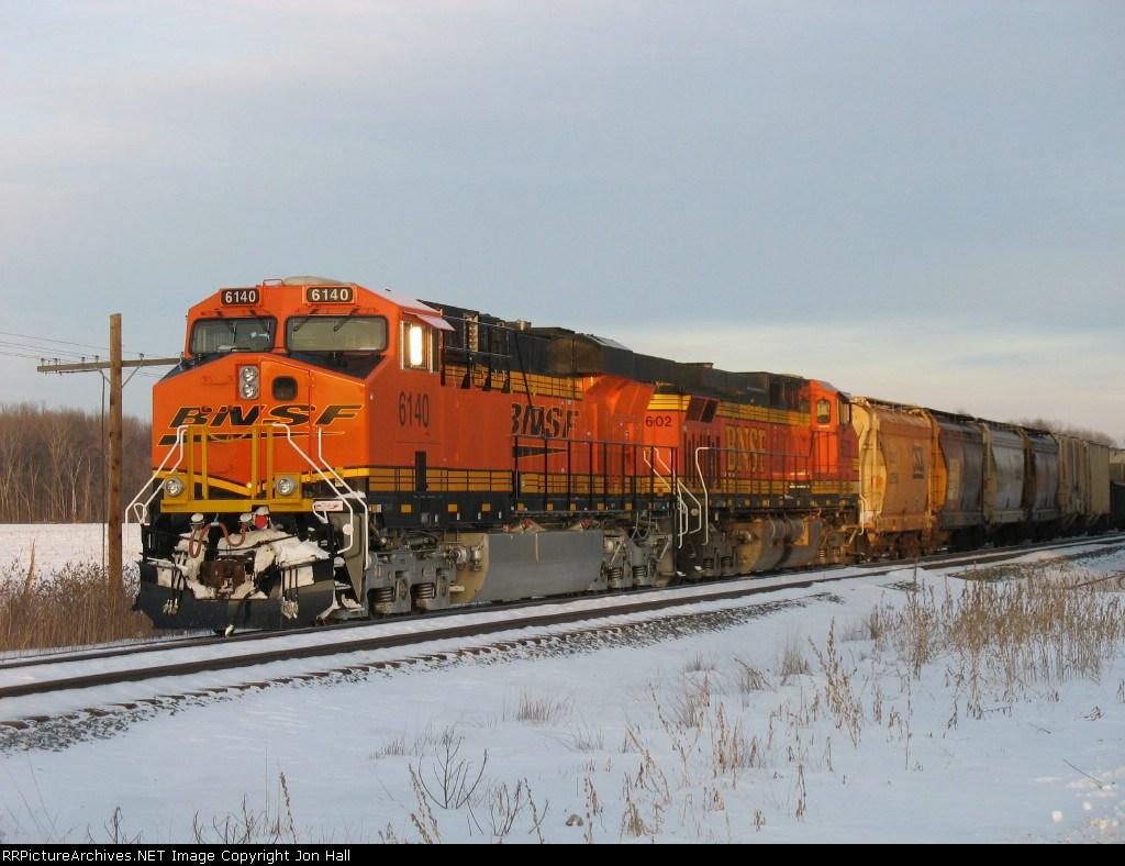 BNSF 6140 & 5602 rest as the setting sun glints off them