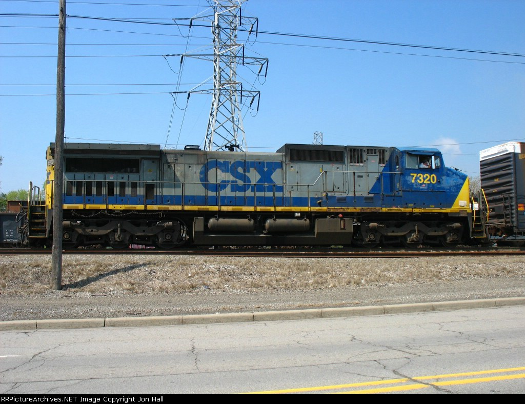 CSX 7320 being used to kick cars at the south end of the yard