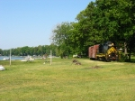 The West Michigan Railroad rolling through the backyards and along Lake Cora