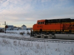 BNSF 6140 waiting with a classic scene behind it