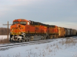 BNSF 6140 & 5602 rest as the setting sun glints off them