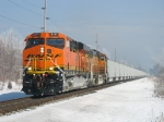 BNSF 6141 leading D801 with cars that match the frosty landscape