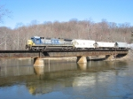 CSX 7581 leading Q327 west over the Kalamazoo River