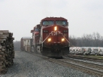 With the sand flying, CP 9816 leads X500 over the summit of Saugatuck Hill