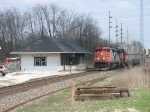 CN 2424 leading Q149 across the diamond and past the depot