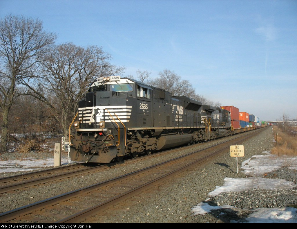 NS 2685 & 9754 pulling their train past MP 488