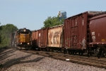 UP 2218 & 9870 rolling south past a northward CSX train