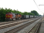 BNSF 795 & 4849 rolling along slowly northward on the elevated IC mainline with C765