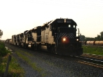 HLCX 7188 leads Q501 eastward out of the low sun