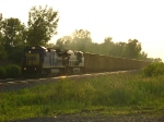 CSX 7532 & 5250 rolling Q388-06 out of the bright setting sun