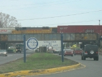 Taken through the windshield while waiting to turn left, UPY 813 works between Yard 9 and the hump