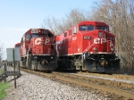 CP 6034 & 8838 wait with their trains for the Metra rush to end