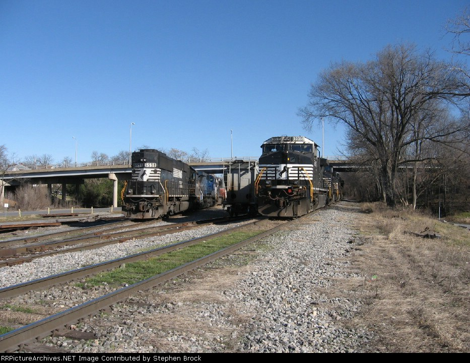 An SD60, a C40-8W along with five C40-9W's
