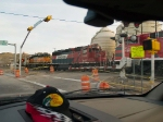 BNSF 7215, FXE 3231 and FXE 4602 make the grade crossing at 7:15am EB