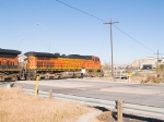 BNSF 4017 leads empty grain hoppers WB (north) at 9:18am