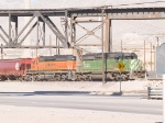 FURX 7045, BNSF 6895 bring a covered hopper consist EB