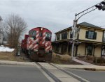 Black River (BDRV) SW1200RS 8159 with a centerbeam flat in tow at Main Street (CNJ passenger station)