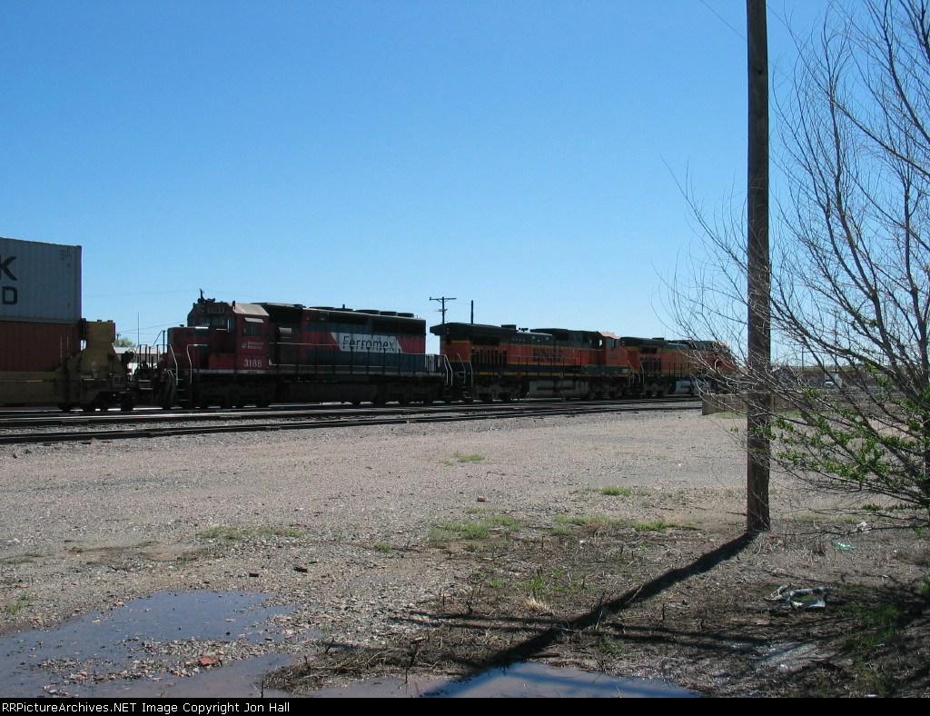 FXE 3188 following behind BNSF 1093 & 4690