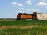BNSF 5076 soloing on a autorack train