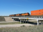 BNSF 5094, 4178, 4886 & 4125 crossing I-27