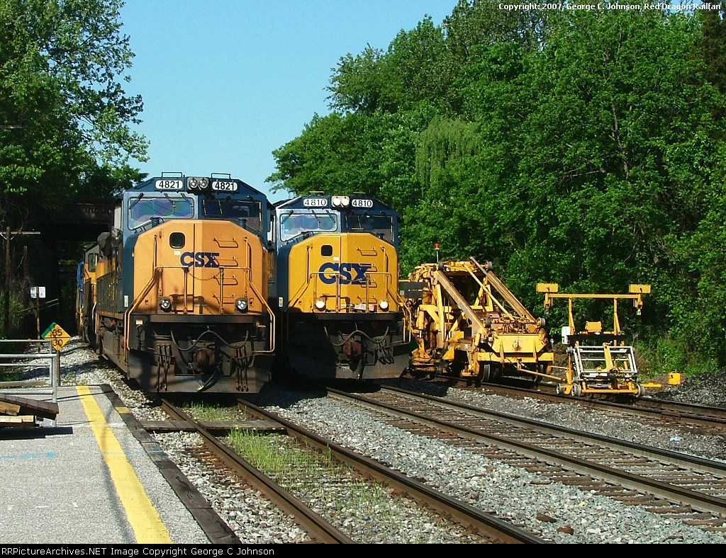 Mow equipment passing parked freight