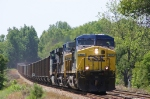 Northbound hoppers pass an old ACL whistle marker
