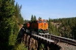 BNSF 7714 leads an eastbound across the Quartz Creek Trestle