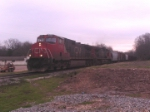 During Lunch time on a cold cloudy day a fast moving train North bound CN