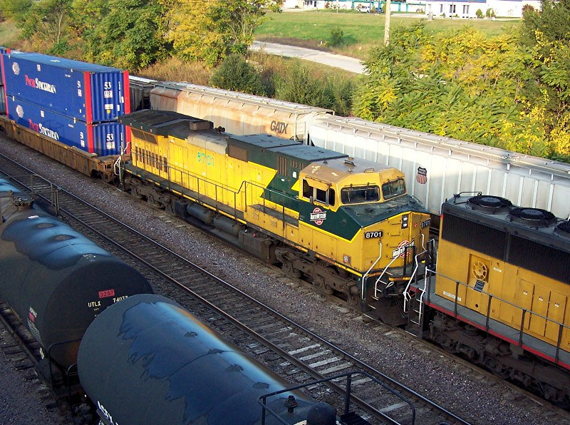 CNW 8701 trails on an EB stacker parked for a crew change