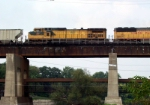 CNW 8637 trails on an EB across the Fox River bridge