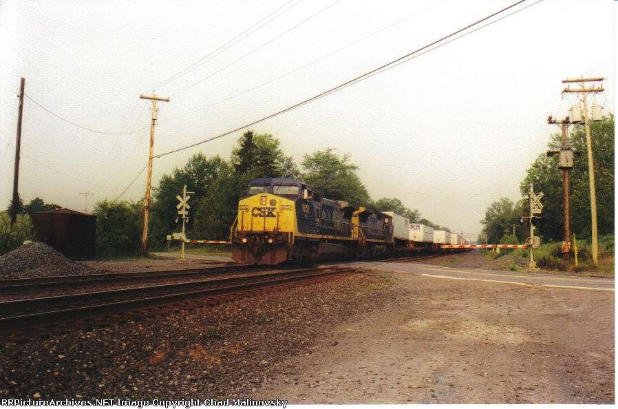 CSX 9052 does the big crossover move